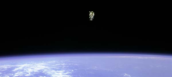 an astronaut floating in space - photo #42