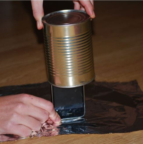 Placing a phone in the tin