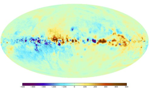 The sky map of the Faraday effect caused by the magnetic fields of the Milky Way. Red and blue colors indicate regions of the sky where the magnetic field points toward and away from the observer, respectively. The band of the Milky Way (the plane of the Galactic disk) extends horizontally in this panoramic view. The center of the Milky Way lies in the middle of the image. The North celestial pole is at the top left and the South Pole is at the bottom right. (Image Credit: Max Planck Institute for Astrophysics)