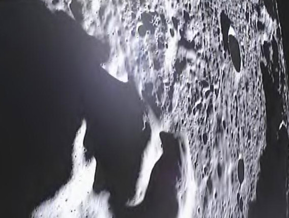 One of the last images from NASA's lunar GRAIL spacecraft, taken from a height of about 10 km. Note the edge of the Moon at the upper right.