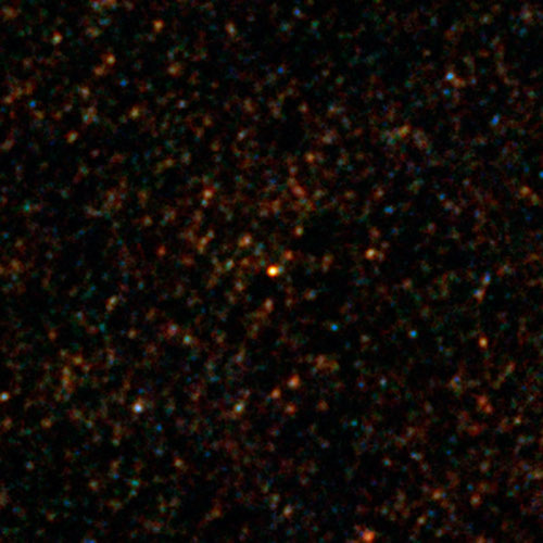 The pair of galaxies seen as they were on their discovery, as a bright red dot in a Herschel image. Image credit: ESA/Herschel/SPIRE/HerMES