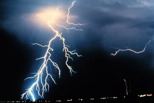 What initiates a lightning strike? In the image above, multiple cloud-to-ground and cloud-to-cloud lightning strikes are observed during a night-time thunderstorm. (Courtesy: NOAA)