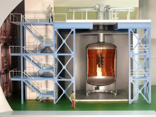 This model of the GERDA experiment shows the onion-like structure which suppresses interfering signals from the environment. The germanium diodes in the center of the cryostat filled with liquid argon (–186°C) are to a larger scale. Credit: MPI for Nuclear Physics