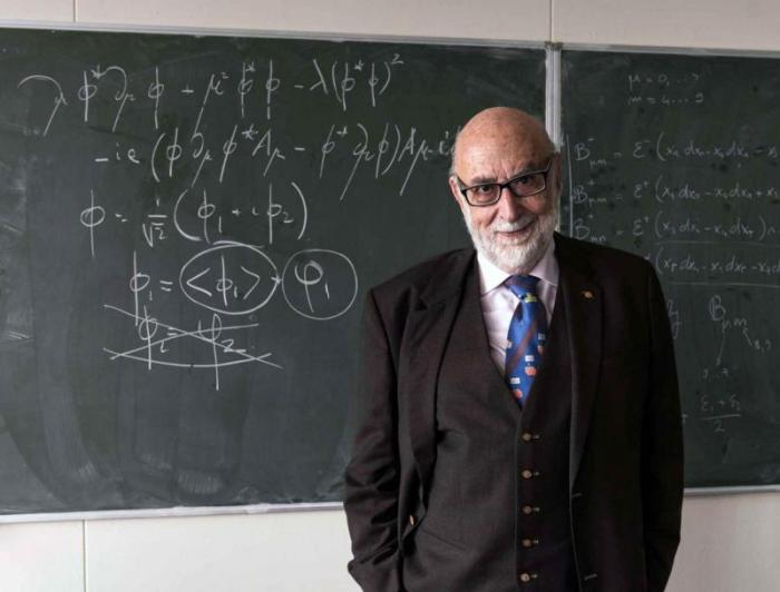 Nobel laureate François Englert at CERN last week. The equation on the blackboard describes the Brout-Englert-Higgs mechanism that gives particles mass (Image: Maximilien Brice)