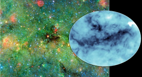 Astronomers have found cosmic clumps so dark, dense and dusty that they throw the deepest shadows ever recorded. Image credit: NASA/JPL-Caltech/University of Zurich