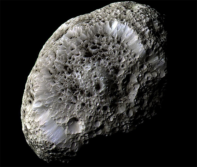 This stunning false-color view of Saturn's moon Hyperion reveals crisp details across the strange, tumbling moon's surface. Differences in color could represent differences in the composition of surface materials. The view was obtained during Cassini's very close flyby on Sept. 26, 2005.
