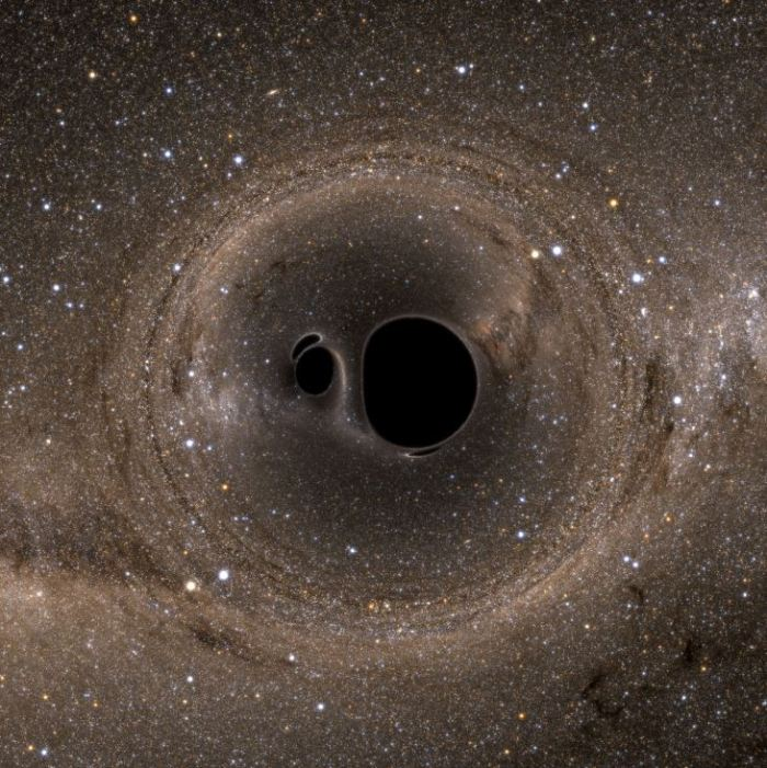 A pair of black holes that are about to merge, with the Milky Way visible in the background.