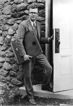 Clyde W. Tombaugh at the door of the Pluto discovery telescope, Lowell Observatory, Arizona (Photo courtesy of Lowell Observatory Archives)